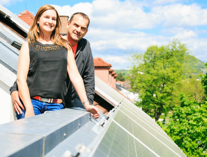 Couple Near Rooftop Home Solar Panel Installation